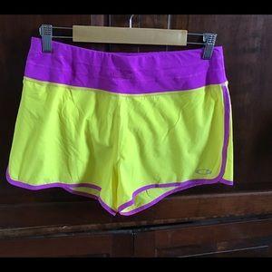 Oakley yellow & purple running shorts, EUC, Med.